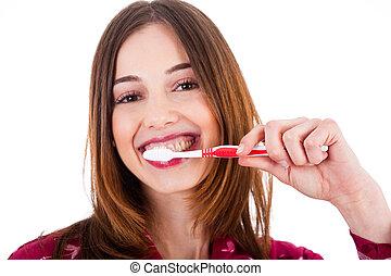 Women brushing her teeth