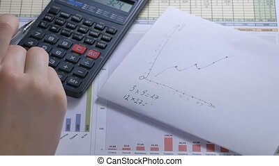 Women businesswoman using calculator. Secretary hands working with calculator.