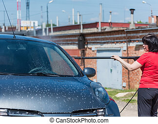 women car washes automatic high pressure - brunette woman,...