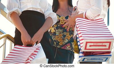 Women Carrying Shopping Bags