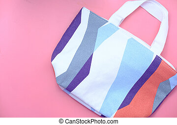 women casual bag on pink background top view.