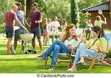 Women chatting on a garden party