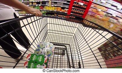 Women choose food in supermarket