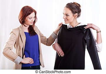 Women choosing clothes together