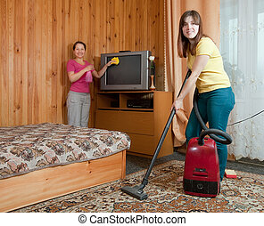 Women cleaning in living room