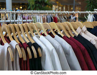 Women clothes hanging on wooden hangers