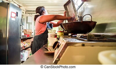 women cooking in outdoor kitchen in