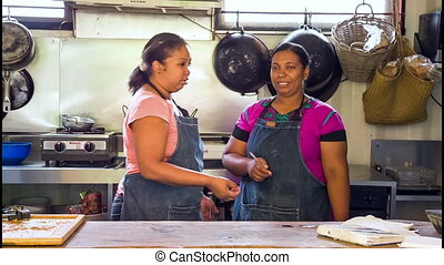 Women cooking in outdoor kitchen