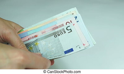 Women counts euro banknotes