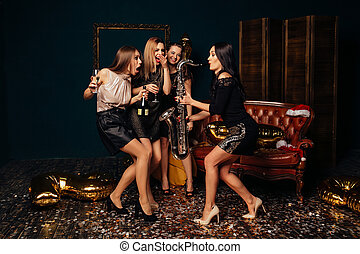 Women dancing and have fun at party