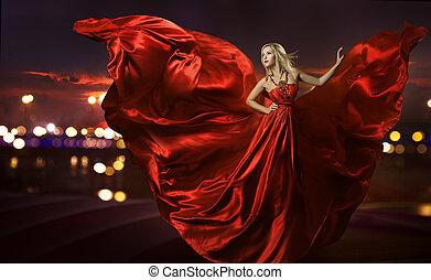 women dancing in silk dress, artistic red blowing gown...