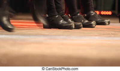 Women dancing Irish dance on stage in a folk festival -...