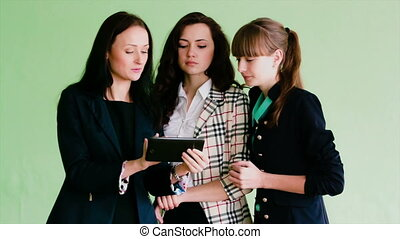Women discussing information on the tablet