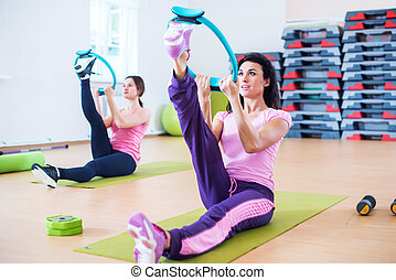Women doing exercises warming up leg stretching workout