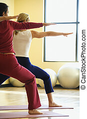 Women doing yoga. - Caucasian prime adult females in yoga...