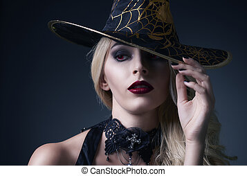 Women dressed up as a scary witch