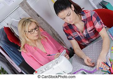Women dressmaking
