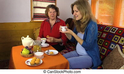 women drink tea