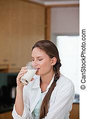 Women drinking a glass of milk