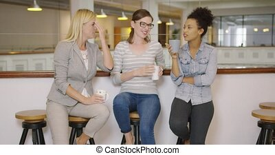 Women drinking coffee and chatting