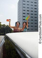 women drinking wine in limousine