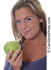 Women Drinks Juice from Apple - Young women pretends to ...