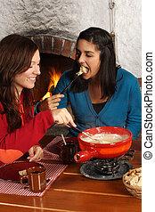 Women eating fondue
