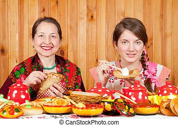 Women eating pancake