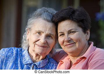 women - elderly woman and her daughter