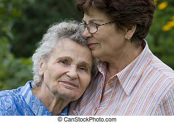 women - elderly woman with her daughter