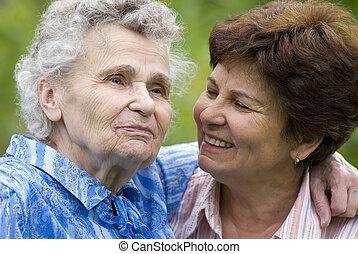 women - elderly woman with her daughter