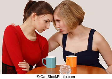 Two women with coffee mugs showing emotional expression