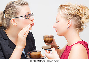 Women enjoying delicious cup of coffee