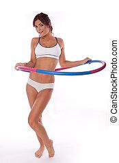 hula hoop - women exercise hula hoop on white background