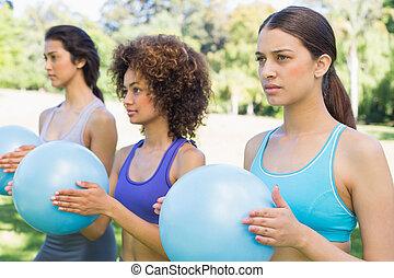 Women exercising with medicine balls