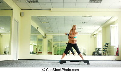 Women exercising with Step