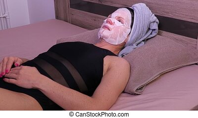 Women fix facial mask on the face