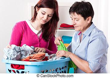 Women folding laundry