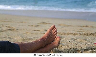 Women foot at a beach