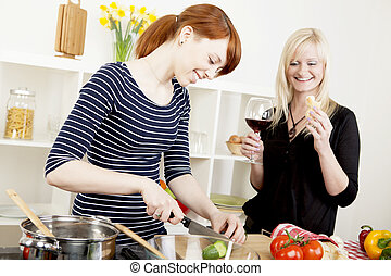 Women friends preparing a meal