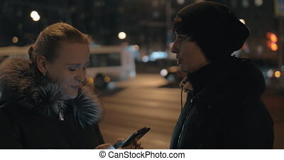 Women friends talking in the street
