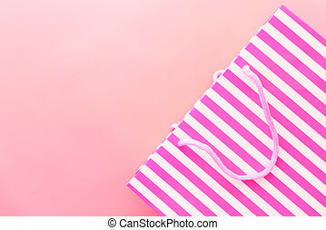women gift bag on pink background top view.