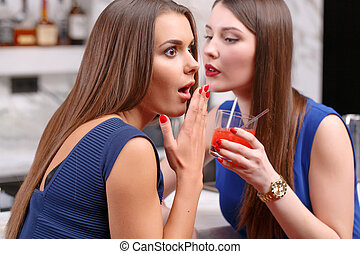 Women gossip in the bar - Cannot believe it. Close-up of a...