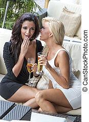 Women Gossiping - Two women gossip while having cocktails