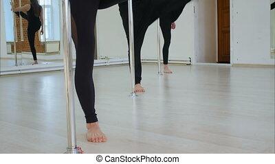 Women group stretching near pylon in gym. Professional shot...