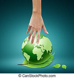 Women hand and green world