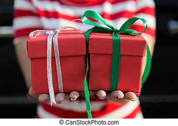 Women hand holding red gift box