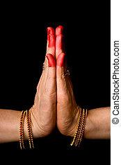 Women hands showing Anjali hasta of indian classic dance...