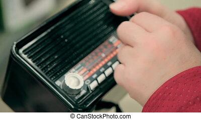 Women hands twist handles old, retro FM receiver. Concept nostalgia, design and collecting. Technical data 4K footage, 25 fps, ProRes, 10 bit color