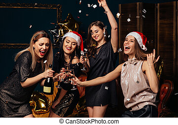 Women have fun at Christmas party
